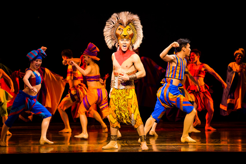 """Shanghai Disneyland proudly presents the first-ever Mandarin stage production of the Broadway hit, THE LION KING. Guests can celebrate the """"Circle of Life"""" during one of the most popular and acclaimed musicals of all time at the lavish 1,200-seat Walt Disney Grand Theatre in Disneytown. With breathtaking choreography, costumes, makeup and staging that transport guests to the African savanna and back, THE LION KING is more than entertainment—it's an adventure. (Disney Theatrical Group)"""